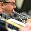 Kyle Bursaw – kbursaw@shawmedia.com<br /> <br /> Kishwaukee Symphony Orchestra trumpet player Kevin Davis performs with the group at practice in the NIU music building on Monday, Feb. 4, 2013.