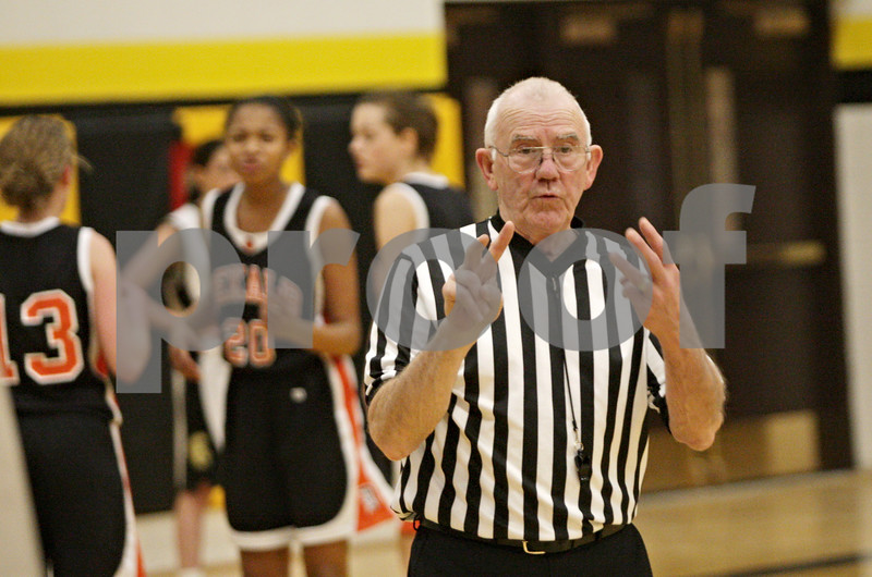 Rob Winner – rwinner@shawmedia.com<br /> <br /> Referee Denny Heins signals to the scorers table during a sophomore girls basketball game in Sycamore,Ill., Thursday, Feb. 7, 2013. Heins is an IHSA official who has been refereeing basketball for 50 years and is retiring.