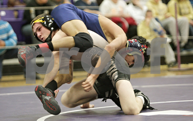 Rob Winner – rwinner@shawmedia.com<br /> <br /> Sycamore's Kyle Akins (left) competes against Belvidere North's Ricardo Roman during their 113-pound finals match at the Class 2A Rochelle Sectional on Saturday, Feb. 9, 2013. Akins won by technical fall.