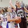 Rob Winner – rwinner@shawmedia.com<br /> <br /> Hinckley-Big Rock's Jacqueline Madden (left) goes to the basket for two points while drawing a foul from Annawan's Morgan VanHyfte (33) in the second quarter during the Class 1A Oglesby Sectional final in Oglesby, Ill., Thursday, Feb. 14, 2013. Annawan defeated H-BR, 64-44.