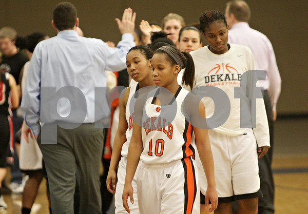 Rob Winner – rwinner@shawmedia.com<br /> <br /> Members of the DeKalb girls basketball team including Brittney Patrick (10) and Courtney Patrick (left) react after falling to Huntley, 50-46, during the Class 4A Belvidere North Regional semifinal in Belvidere, Ill., Tuesday, Feb. 12, 2013.