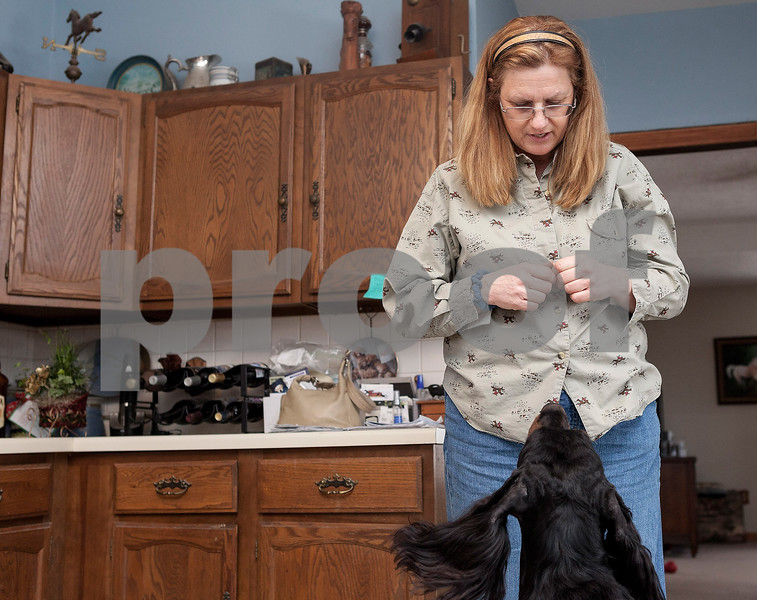 """Erik Anderson - For the Daily Chronicle<br /> <br /> Local dog handler and veterinarian Lynn Kullman holds a treat in her hand and waits for Gatlin to """"stay"""" while at her house in Cortland on  Friday, February 8, 2013."""