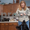 "Erik Anderson - For the Daily Chronicle<br /> <br /> Local dog handler and veterinarian Lynn Kullman holds a treat in her hand and waits for Gatlin to ""stay"" while at her house in Cortland on  Friday, February 8, 2013."
