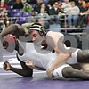 Rob Winner – rwinner@shawmedia.com<br /> <br /> Kaneland's Dan Goress (right) takes Rock Island's Jean-Louis Sawadago to the mat during their 145-pound finals match at the Class 2A Rochelle Sectional on Saturday, Feb. 9, 2013. Goress won with a 5-2 decision.