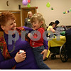 Jeff Engelhardt - jengelhardt@shawmedia.com<br /> Linda Dolder, a member of St. Catherine of Genoa, laughs with her granddaughter during the church's Mardis Gras party Tuesday for residents in the Avancer program. Avancer serves special needs adults in an assisted-living community setting.