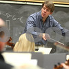 Kyle Bursaw – kbursaw@shawmedia.com<br /> <br /> Kishwaukee Symphony Orchestra director Linc Smelser leans in toward the group while conducting a quieter portion of a song on Monday, Feb. 4, 2013 in the NIU music building.