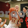 Rob Winner – rwinner@shawmedia.com<br /> <br /> DeKalb's Madelyne Johnson (23) looks to shoot while being defended by Huntley's Sam Andrews in the fourth quarter during the Class 4A Belvidere North Regional semifinal in Belvidere, Ill., Tuesday, Feb. 12, 2013.