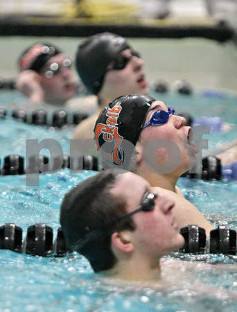 Rob Winner – rwinner@shawmedia.com<br /> <br /> DeKalb-Sycamore co-op swimmer Daniel Hein (second from bottom) reacts after checking his time after competing in the 100 butterfly during the St. Charles East Sectional on Saturday, Feb. 16, 2013. Hein finished first with a time of 49.70.