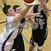 Rob Winner – rwinner@shawmedia.com<br /> <br /> Hinckley-Big Rock's Mitch Ruh (left) puts up two points in the third quarter during the Class 1A Westminster Christian Regional semifinals in Elgin, Ill., Tuesday, Feb. 20, 2013. H-BR defeated Harvest Christian, 44-33.