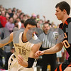 Kyle Bursaw – kbursaw@shawmedia.com<br /> <br /> Sycamore's Devin Mottet makes a move to try to get past DeKalb's Jake Carpenter in the first quarter of their game at Sycamore High School on Friday, Feb. 22, 2013.