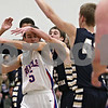 Rob Winner – rwinner@shawmedia.com<br /> <br /> Hinckley-Big Rock's Bernie Conley (5) is pressured by three Harvest Christian defenders before getting a pass off in the third quarter during the Class 1A Westminster Christian Regional semifinals in Elgin, Ill., Tuesday, Feb. 20, 2013. H-BR defeated Harvest Christian, 44-33.
