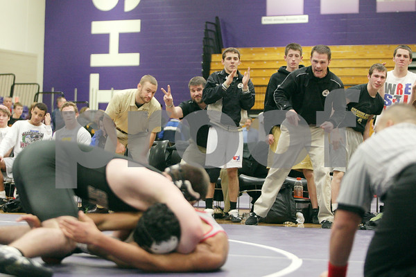 Rob Winner – rwinner@shawmedia.com<br /> <br /> Sycamore coach Alex Nelson (right) reacts as Ren Swick (left) competes with Yorkville's Tyler Wilkinson in their 170-pound match during the Class 2A Rochelle Dual Team Sectional on Tuesday, Feb. 19, 2013. Swick won with a 6-2 decision. Sycamore defeated Yorkville, 30-28.