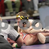 Rob Winner – rwinner@shawmedia.com<br /> <br /> Sycamore's Kyle Akins (top) pins Yorkville's Nick Mohr in their 113-pound match during the Class 2A Rochelle Dual Team Sectional on Tuesday, Feb. 19, 2013. Sycamore defeated Yorkville, 30-28.