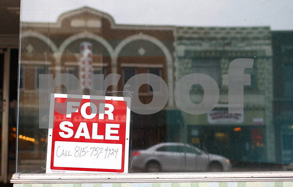 Kyle Bursaw – kbursaw@shawmedia.com<br /> <br /> A vacant store at 237 East Lincoln Highway reflects downtown DeKalb on Monday, Feb. 18, 2013.