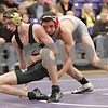 Rob Winner – rwinner@shawmedia.com<br /> <br /> Sycamore's Brendon McGehee (left) competes with Yorkville's Brody Sharp in their 132-pound match during the Class 2A Rochelle Dual Team Sectional on Tuesday, Feb. 19, 2013. McGehee won with a 3-2 decision. Sycamore defeated Yorkville, 30-28.