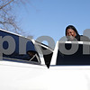 "Rob Winner – rwinner@shawmedia.com<br /> <br /> DeKalb resident Shatoya Black is all smiles before getting into a limousine for a ride over to Kishwaukee Community Hospital for the third annual ""This One's for the Girls"" expo on Saturday, Feb. 16, 2013. Black, a single mother and cancer survivor, was the winner of Kishwaukee Community Hospital's ""This One's for the Girls"" limousine contest."