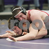 Rob Winner – rwinner@shawmedia.com<br /> <br /> Yorkville's Bobby Schillinger (top) controls Sycamore's Chris Malone in their 182-pound match during the Class 2A Rochelle Dual Team Sectional on Tuesday, Feb. 19, 2013. Schillinger won by decision. Sycamore defeated Yorkville, 30-28.