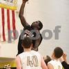 Kyle Bursaw – kbursaw@shawmedia.com<br /> <br /> DeKalb's Justin Love puts up a shot in the third quarter against the Spartans at Sycamore High School on Friday, Feb. 22, 2013.