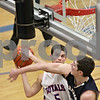 Rob Winner – rwinner@shawmedia.com<br /> <br /> Hinckley-Big Rock's Bernie Conley (5) is fouled by Harvest Christian's Stuart Wolff in the fourth quarter during the Class 1A Westminster Christian Regional semifinals in Elgin, Ill., Tuesday, Feb. 20, 2013. H-BR defeated Harvest Christian, 44-33.