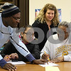 Kyle Bursaw – kbursaw@shawmedia.com<br /> <br /> Victor Obijuru (front row from left), Brenda Lara and Lee Vaughn work together to calculate interest on a problem given to them by instructor Julie Axelsen (back) during a G.E.D. class focused on math at Westminster Presbyterian Church in DeKalb, Ill. on Monday, Feb. 18, 2013.