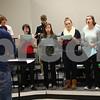 Kyle Bursaw – kbursaw@shawmedia.com<br /> <br /> Enharmonic Fusion director Travis Erikson leads the group as they rehearse One Direction's 'What Makes You Beautiful' in DeKalb, Ill. on Tuesday, Feb. 12, 2013. Enharmonic Fusion is DeKalb High School's a capella group.