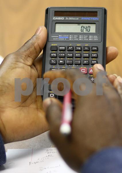 Kyle Bursaw – kbursaw@shawmedia.com<br /> <br /> Victor Obijuru makes a calculation during a G.E.D. class focused on math at Westminster Presbyterian Church in DeKalb, Ill. on Monday, Feb. 18, 2013.
