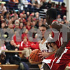Rob Winner – rwinner@shawmedia.com<br /> <br /> Hinckley-Big Rock's Bernie Conley is pressured by Mooseheart's Hameed Odenewu (right) in the second quarter during the Class 1A Westminster Christian Regional final at Judson University in Elgin, Ill., Friday, Feb. 22, 2013. Mooseheart defeated Hinckley-Big Rock, 55-38.