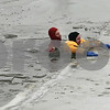 Firefighters Todd Adamson (left) and Andrew Romano (right) simulate an ice rescue Thursday at Rotary Park in DeKalb. (Stephanie Hickman - shickman@shawmedia.com)