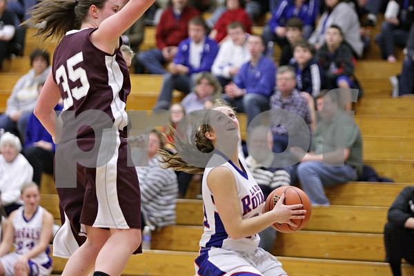 Rob Winner – rwinner@shawmedia.com<br /> <br /> Hinckley-Big Rock's Lauren Paver (right) looks to shoot as Annawan's Celina VanHyfte defends in the third quarter during the Class 1A Oglesby Sectional final in Oglesby, Ill., Thursday, Feb. 14, 2013. Annawan defeated H-BR, 64-44.