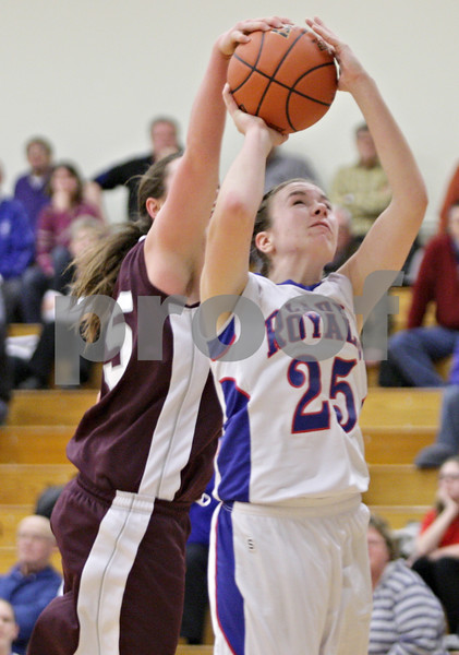 Rob Winner – rwinner@shawmedia.com<br /> <br /> Hinckley-Big Rock's Abbie Tosch (25) has her shot blocked from behind by Annawan's Celina VanHyfte in the third quarter during the Class 1A Oglesby Sectional final in Oglesby, Ill., Thursday, Feb. 14, 2013. Annawan defeated H-BR, 64-44.