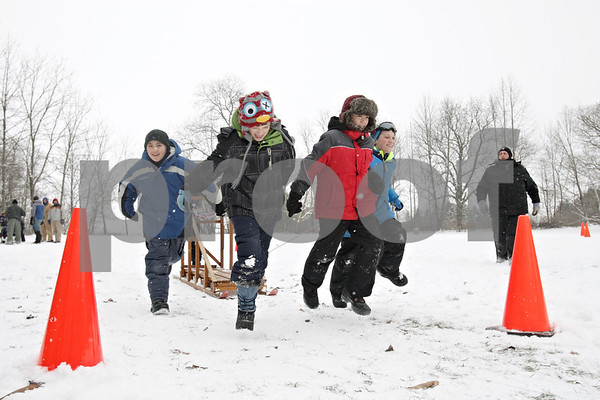 Rob Winner – rwinner@shawmedia.com<br /> <br /> Members of Sycamore Webelos II Pack 141 compete in a sled race during the annual Klondike Derby held at Sycamore's Sportsman's Club in Sycamore, Ill., Saturday, Feb. 2, 2013.