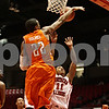Rob Winner – rwinner@shawmedia.com<br /> <br /> Bowling Green's Richaun Holmes (22) blocks a shot by Northern Illinois' Daveon Balls (11) during the first half in DeKalb, Ill., Wednesday, Feb. 6, 2013.