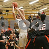 Rob Winner – rwinner@shawmedia.com<br /> <br /> Kaneland's John Pruett (5) is fouled by DeKalb's Jake Smith in the first quarter during their game in Maple Park, Ill., Friday, Feb. 8, 2013. DeKalb defeated Kaneland, 50-45.