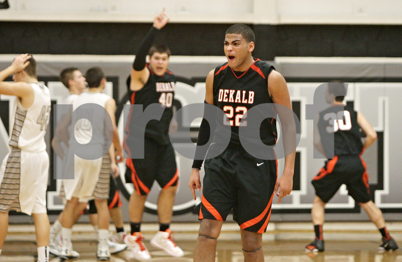 Rob Winner – rwinner@shawmedia.com<br /> <br /> DeKalb's Andre Harris (22) celebrates the Barbs' 50-45 victory over Kaneland in Maple Park, Ill., Friday, Feb. 8, 2013.