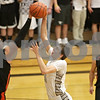Rob Winner – rwinner@shawmedia.com<br /> <br /> DeKalb's Jake Smith (40) partially blocks a shot by Kaneland's John Pruett in the third quarter during their game in Maple Park, Ill., Friday, Feb. 8, 2013. DeKalb defeated Kaneland, 50-45.