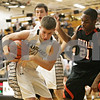 Rob Winner – rwinner@shawmedia.com<br /> <br /> Kaneland's Drew David (left) controls a defensive rebound ahead of DeKalb's Riccardo Pitts (21) in the second quarter during their game in Maple Park, Ill., Friday, Feb. 8, 2013. DeKalb defeated Kaneland, 50-45.