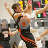 Rob Winner – rwinner@shawmedia.com<br /> <br /> DeKalb's Pat Aves loses the ball after being pressured by two Kaneland defenders in the second quarter during their game in Maple Park, Ill., Friday, Feb. 8, 2013. DeKalb defeated Kaneland, 50-45.