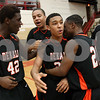 Kyle Bursaw – kbursaw@shawmedia.com<br /> <br /> DeKalb's Justin Love (42), Riccardo Pitts (right) and another DeKalb player surround Rudy Lopez (center) following DeKalb's 55-52 victory over Belvidere North in the Class 4A Rockford East regional quarterfinal game at Rockford East High School on Monday, Feb. 25, 2013.