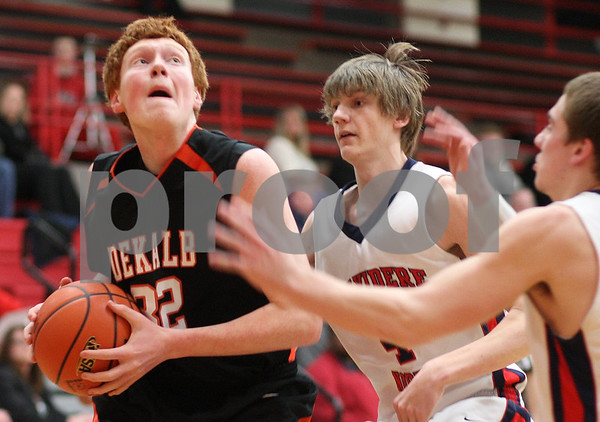 Kyle Bursaw – kbursaw@shawmedia.com<br /> <br /> DeKalb's Micah Fagerstrom looks to shoot against Belvidere North during the first quarter of the Class 4A Rockford East regional quarterfinal game at Rockford East High School on Monday, Feb. 25, 2013.