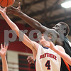 Kyle Bursaw – kbursaw@shawmedia.com<br /> <br /> DeKalb's Justin Love battles Belvidere North's Todd Berknpas for a rebound during the second quarter of the Class 4A Rockford East regional quarterfinal game at Rockford East High School on Monday, Feb. 25, 2013.