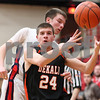 Kyle Bursaw – kbursaw@shawmedia.com<br /> <br /> DeKalb's Zach Ottum loses control of the ball during the first quarter of the Class 4A Rockford East regional quarterfinal against Belvidere North at Rockford East High School on Monday, Feb. 25, 2013.