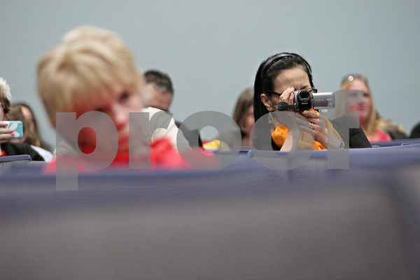 Rob Winner – rwinner@shawmedia.com<br /> <br /> Yung Cong-Huyen uses a camcorder to record her daughter Katrina Baum (not pictured) in the third round during the DeKalb County Spelling Bee at Kishwaukee College in Malta, Ill., Saturday, Feb. 23, 2013.