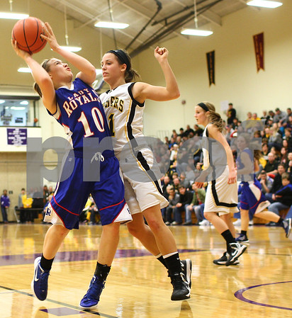 Kyle Bursaw – kbursaw@shawmedia.com<br /> <br /> Hinckley-Big Rock's Jacqueline Madden  puts up a shot in the face of Putnam County's Stephanie Wilson in the third quarter of Hinckley-Big Rock's 40-32 victory over Putnam County in the Class 1A Oglesby Sectional at Illinois Valley Community College in Oglesby, Ill. on Monday, Feb. 11, 2013.