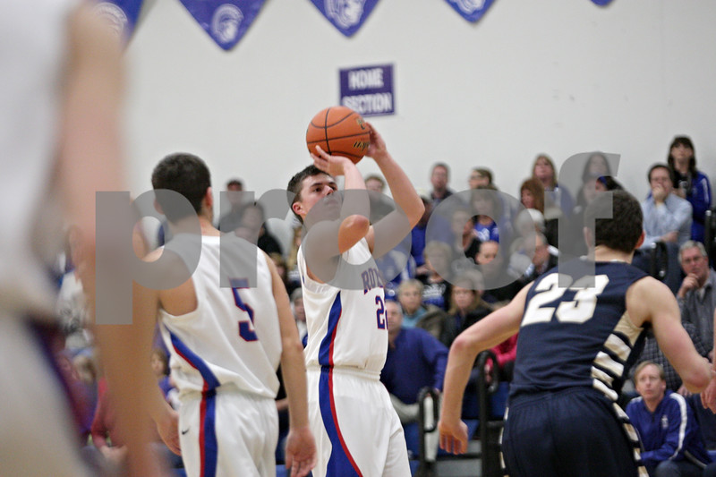 Rob Winner – rwinner@shawmedia.com<br /> <br /> Hinckley-Big Rock's Mitch Ruh takes a shot in the first quarter during the Class 1A Westminster Christian Regional semifinals in Elgin, Ill., Tuesday, Feb. 20, 2013. H-BR defeated Harvest Christian, 44-33.