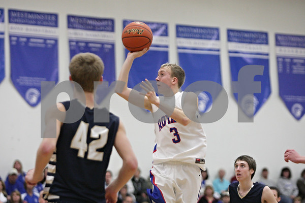 Rob Winner – rwinner@shawmedia.com<br /> <br /> Hinckley-Big Rock's Jared Madden (center) takes a shot in the third quarter during the Class 1A Westminster Christian Regional semifinals in Elgin, Ill., Tuesday, Feb. 20, 2013. H-BR defeated Harvest Christian, 44-33.