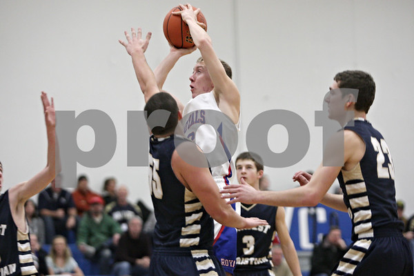 Rob Winner – rwinner@shawmedia.com<br /> <br /> Hinckley-Big Rock's Jared Madden (center) takes a shot in the second quarter during the Class 1A Westminster Christian Regional semifinals in Elgin, Ill., Tuesday, Feb. 20, 2013. H-BR defeated Harvest Christian, 44-33.