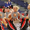 Rob Winner – rwinner@shawmedia.com<br /> <br /> DeKalb's Madelyne Johnson (23) is called for fouling Huntley's Bethany Zornow while struggling for possession of a ball in the second quarter during the Class 4A Belvidere North Regional semifinal in Belvidere, Ill., Tuesday, Feb. 12, 2013.