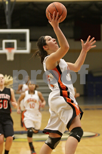 Rob Winner – rwinner@shawmedia.com<br /> <br /> After a steal, DeKalb's Rachel Torres puts up two points with a layup in the first quarter during the Class 4A Belvidere North Regional semifinal in Belvidere, Ill., Tuesday, Feb. 12, 2013.