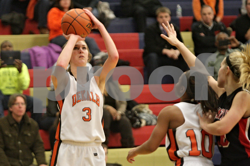 Rob Winner – rwinner@shawmedia.com<br /> <br /> DeKalb's Courtney Bemis puts up a shot good for two points in the second quarter during the Class 4A Belvidere North Regional semifinal in Belvidere, Ill., Tuesday, Feb. 12, 2013.