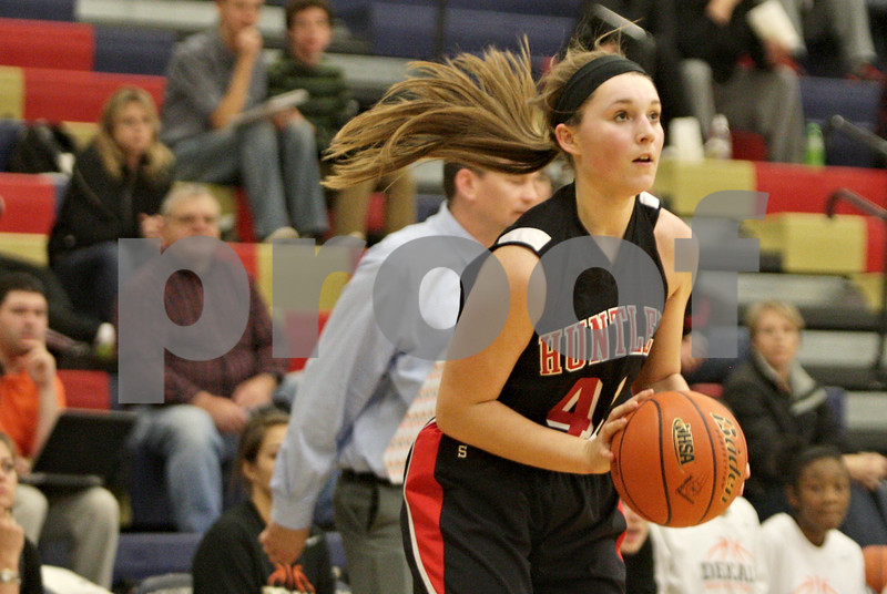 Rob Winner – rwinner@shawmedia.com<br /> <br /> Huntley's Sam Andrews (40) looks to the basket before putting up a shot good for two points in the second quarter during the Class 4A Belvidere North Regional semifinal in Belvidere, Ill., Tuesday, Feb. 12, 2013.